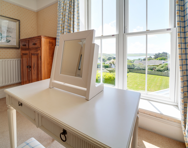 The super king bedroom with stunning Estuary views at The Haven holiday home in Daymer Bay.