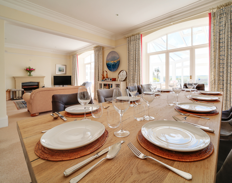 The large dining room table at The Haven self catering holiday home in Daymer Bay on the North Cornish coast.