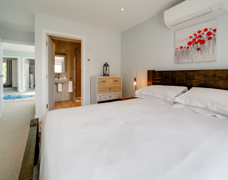 The king bedroom with shower room ensuite at Morwenna holiday home in Daymer Bay north Cornwall.