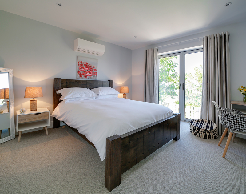 The king bedroom at Morwenna holiday home in Daymer Bay North Cornwall.