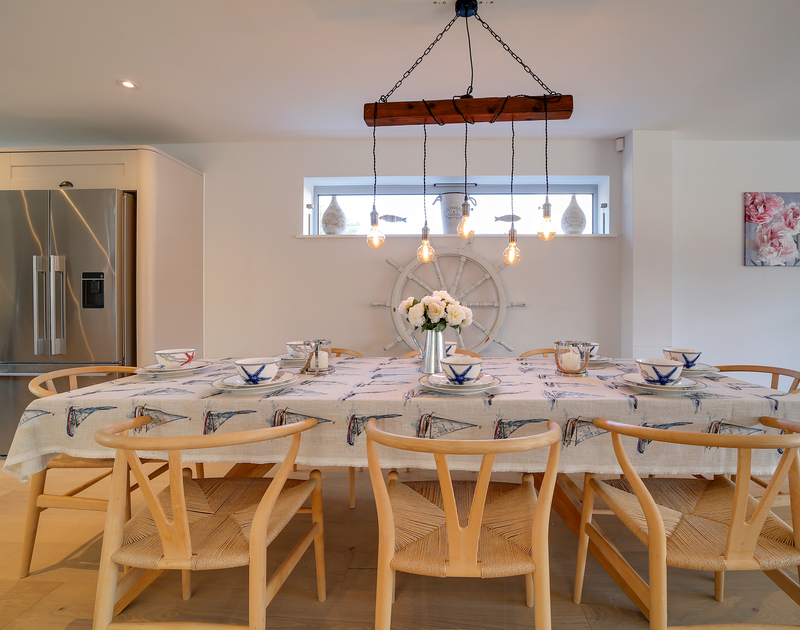 The open plan kitchen, living, dining room at Morwenna self catering holiday home in Daymer Bay, North Cornwall.