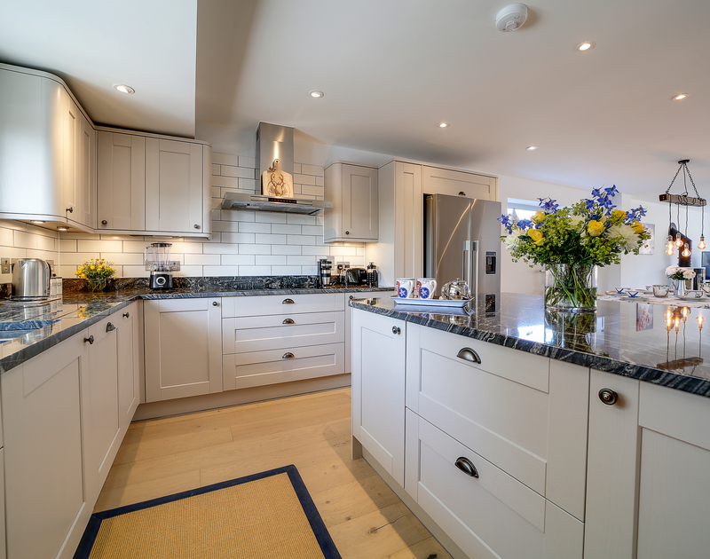 The well-equipped kitchen at Morwenna holiday home in Daymer Bay.