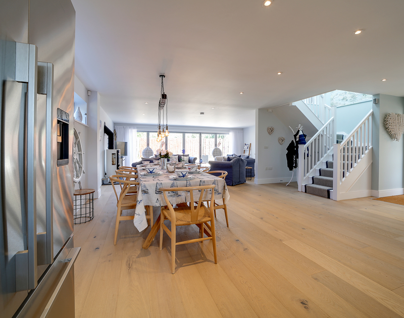 The spacious open plan kitchen, living and dining area at Morwenna holiday home in Daymer Bay, North Cornwall.
