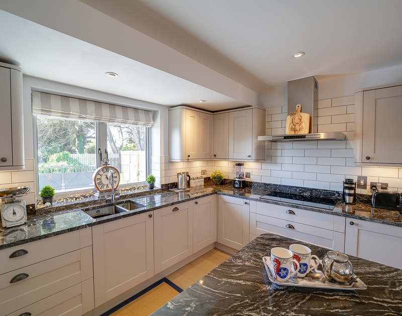 The well-equipped kitchen at Morwenna holiday home in Daymer Bay, North Cornwall.