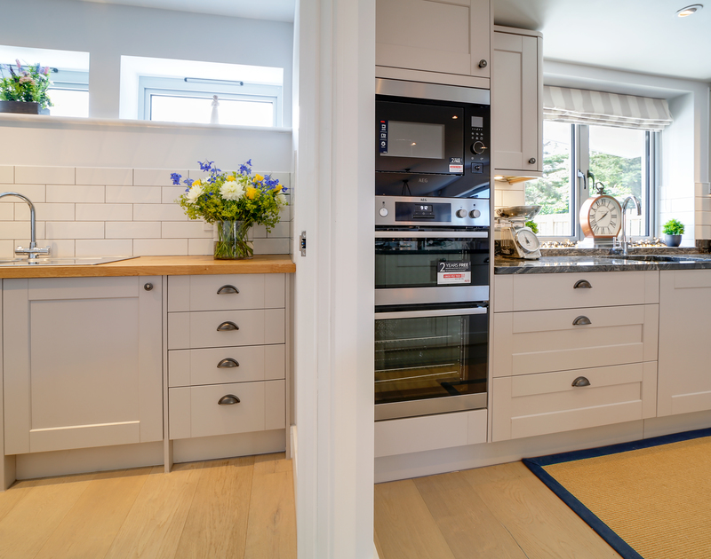 The well-equipped kitchen at Morwenna self catering holiday home in Daymer Bay on the North Cornish coast.