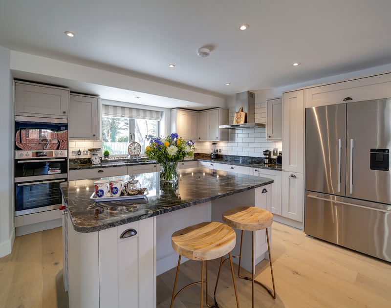 The well-equipped kitchen at Morwenna self catering holiday home in Daymer Bay.