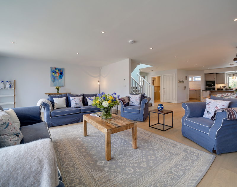 The cosy lounge with wood burner at Morwenna holiday home in Daymer Bay.