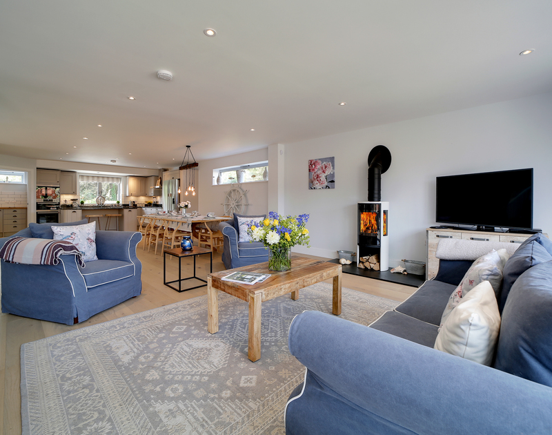 The open plan kitchen, living, dining room at Morwenna self catering holiday home in Daymer Bay.
