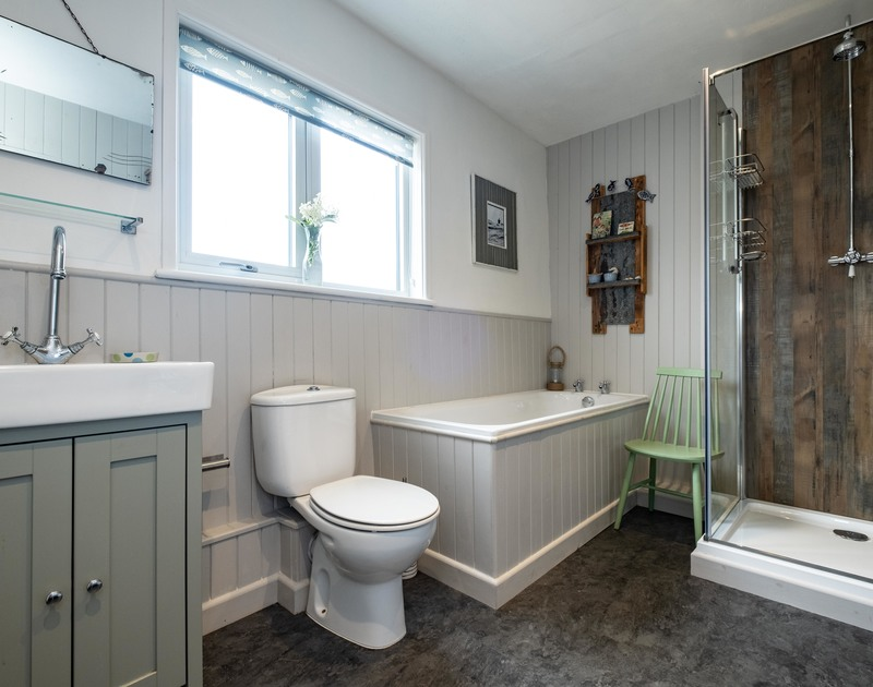 The modern family bathroom at 3 Dolphin Cottages self catering holiday home in Port Isaac, North Cornwall.