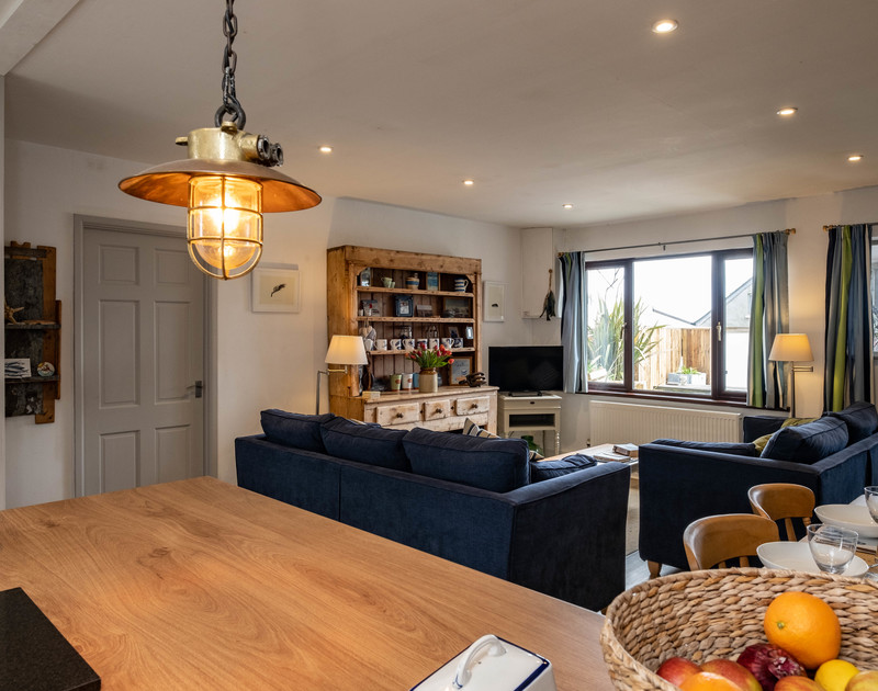 The open plan kitchen, living and dining area at 3 Dolphin Cottages self catering holiday home in Port Isaac.