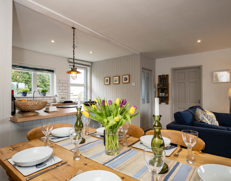 The light filled dining area at 3 Dolphin Cottages self catering holiday home in North Cornwall, perfect for a holiday meal..