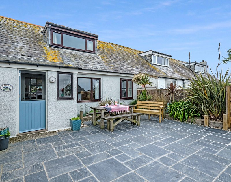 The spacious terrace with outdoor seating at 3 Dolphin Cottages self catering holiday home in Port Isaac, North Cornwall.