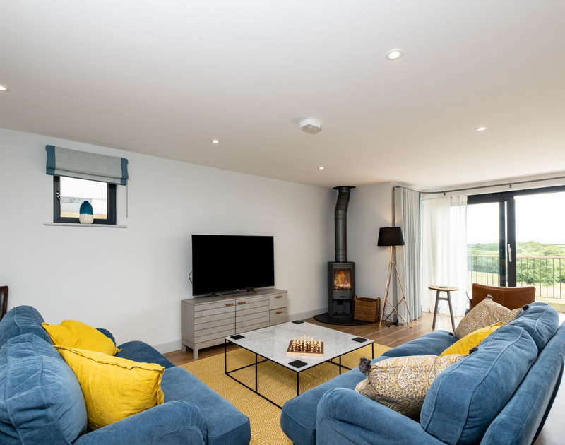 The modern lounge with cosy fire place at Tor View holiday home in St Minver, Rock on the north Cornwall coast.