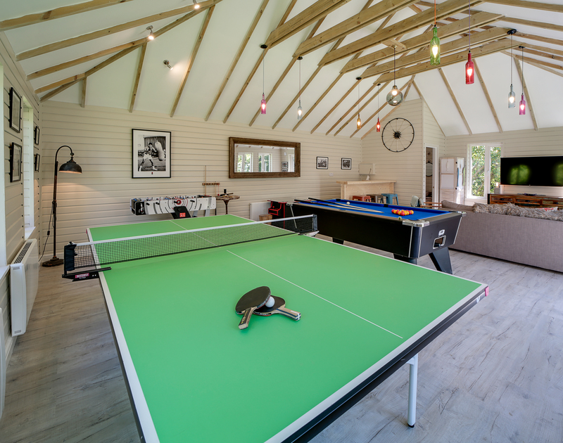 The outside games room with table tennis and pool table at Trevanion in Rock, North Cornwall.