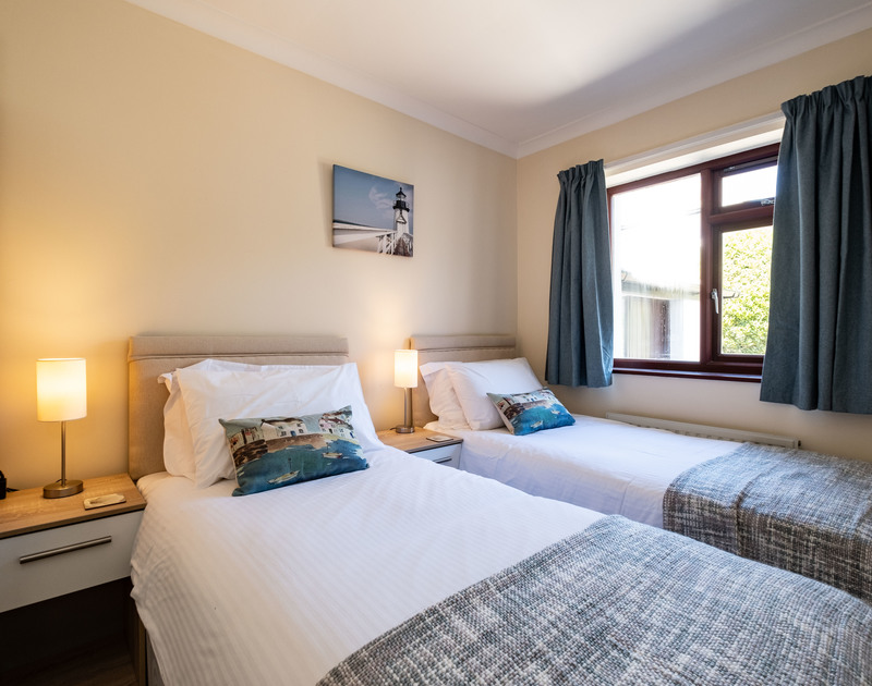 The twin bedroom with Zip and Link beds at Penventon self catering holiday cottage in Port Isaac, Cornwall.