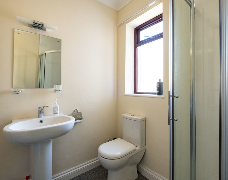 The bathroom with shower at Penventon holiday home in Port Isaac, North Cornwall.