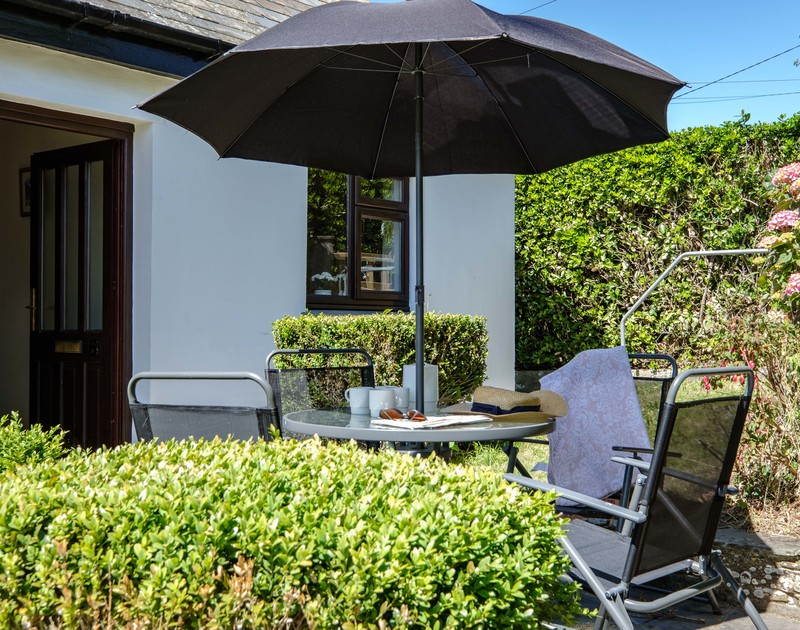 The sunny terrace with outdoor seating at Penventon holiday home Port Isaac.