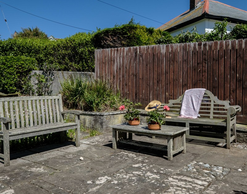 The lovely seating area in the back garden at Penventon holiday home in Port Isaac, Cornwall.