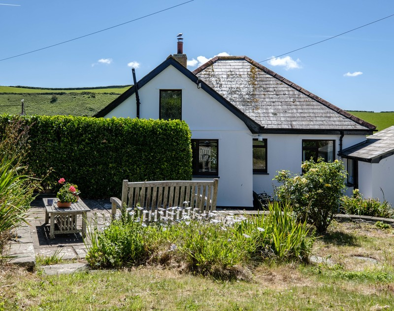 The sunny back garden with seating area at Penventon holiday home in Port Isaac, North Cornwall coast.