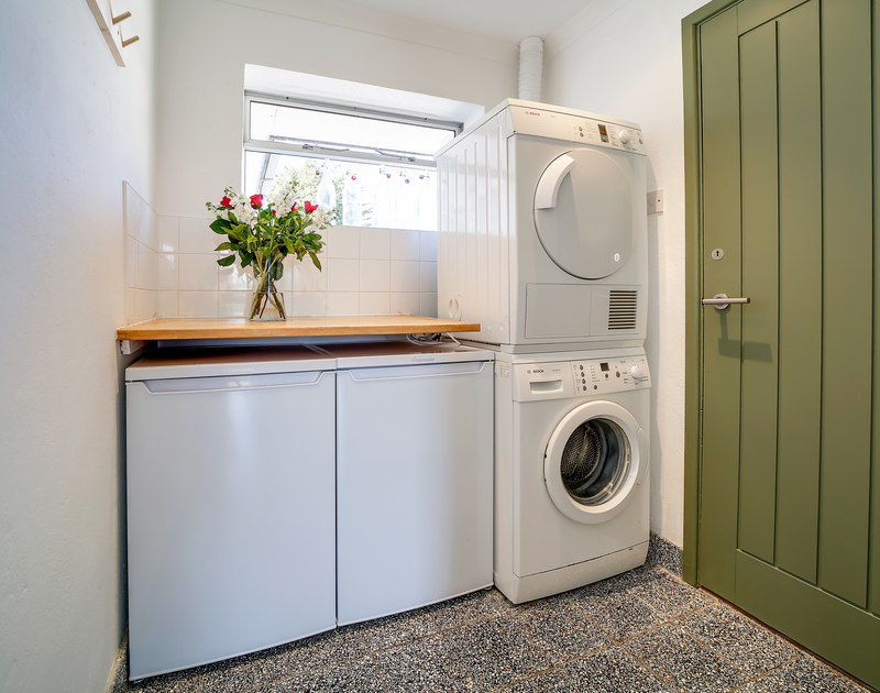 The well-equipped utility room at Sandy Lodge holiday cottage in Daymer Bay on the north Cornwall coast.