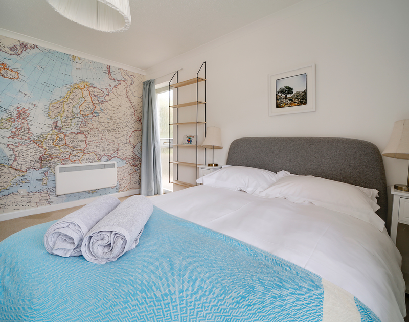 The beautifully decorated king size bedroom at Sandy Lodge self catering holiday home in Daymer Bay, North Cornwall.