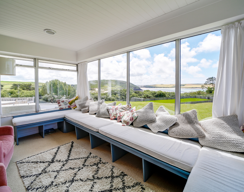 The large window seat overlooking Daymer Bay at Sandy Lodge on the North Cornish coast.
