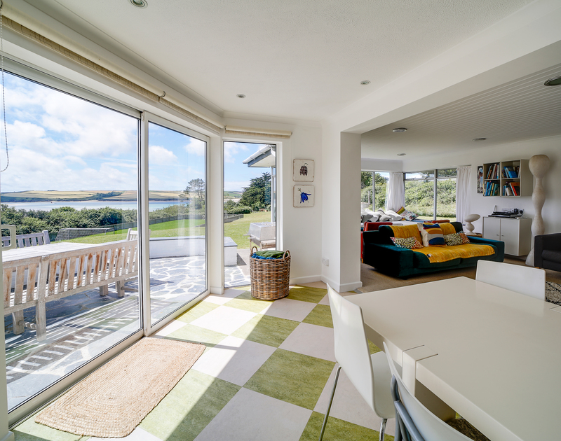 The patio doors in the dining and lounge room at Sandy Lodge self catering holiday home in Daymer Bay, North Cornwall.