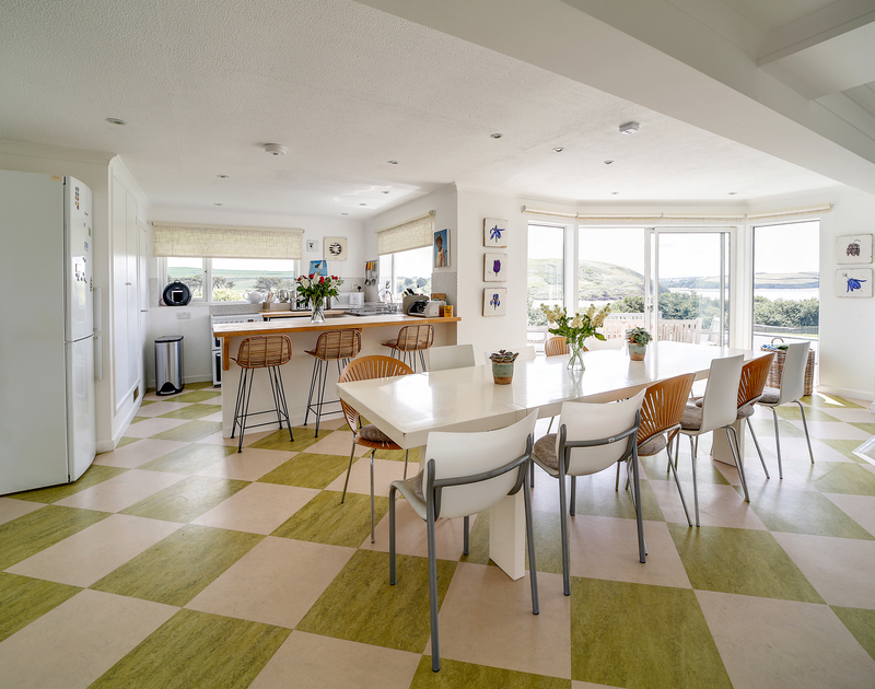 The lovely open plan kitchen, dining and living room at Sandy Lodge self catering holiday house in Daymer Bay, North Cornwall.
