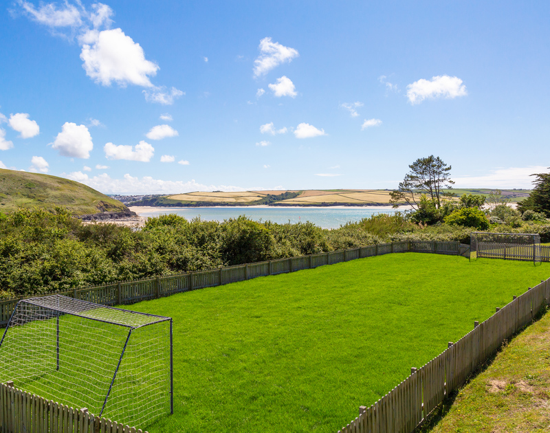 The mini football pitch with amazing sea views at Sandy Lodge holiday home in Daymer Bay, North Cornwall.
