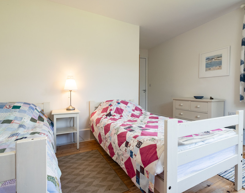 The light filled twin bedroom at Croft Elms self catering holiday home in Daymer Bay, North Cornwall.