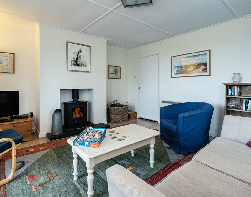 The light filled sitting room with wood burner Croft Elms self catering holiday home in Daymer Bay.