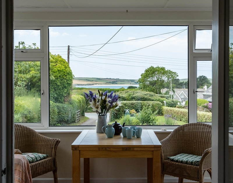 The views of Daymer Bay from the sunroom at Croft Elms self catering holiday home.