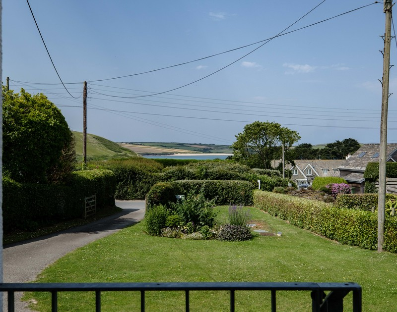The view from the patio of Daymer Bay and the garden at Croft Elms self catering holiday home in Daymer Bay, North Cornwall.