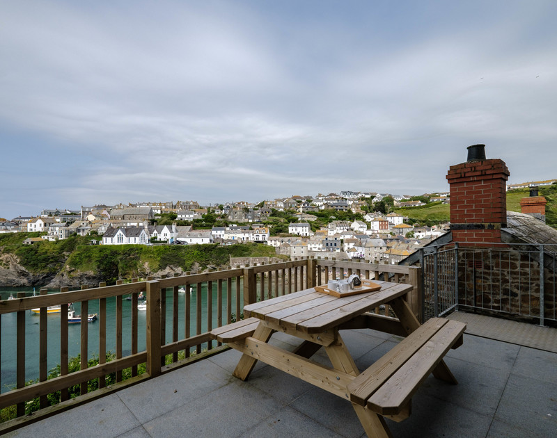 The harbour views from the front terrace at Folly 1 self catering holiday home in Port Isaac.