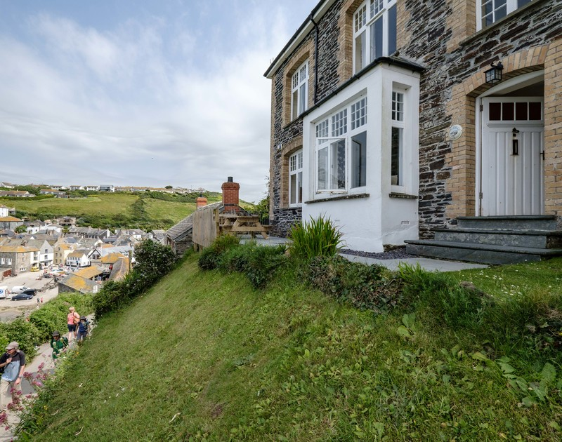 An external view of the front terrace and front door at Folly 1 self catering holiday home in Port Isaac.