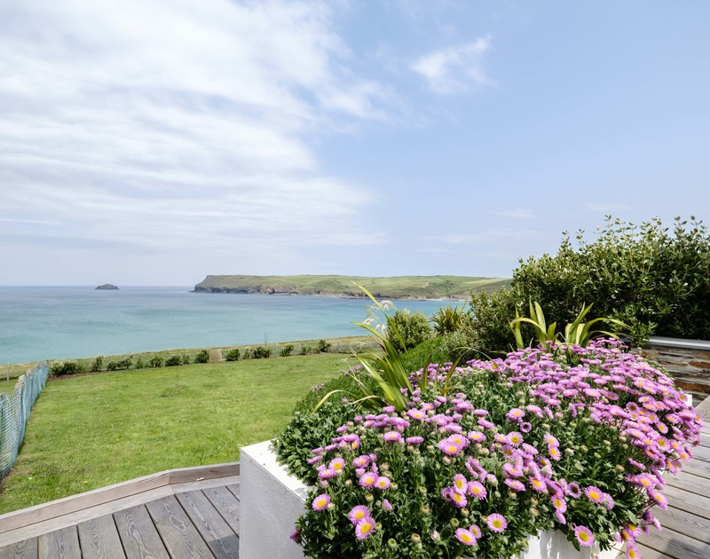 The sea views towards New Polzeath from the sunny terrace at Treleven Cottage, a luxury holiday rental in Polzeath, Cornwall.