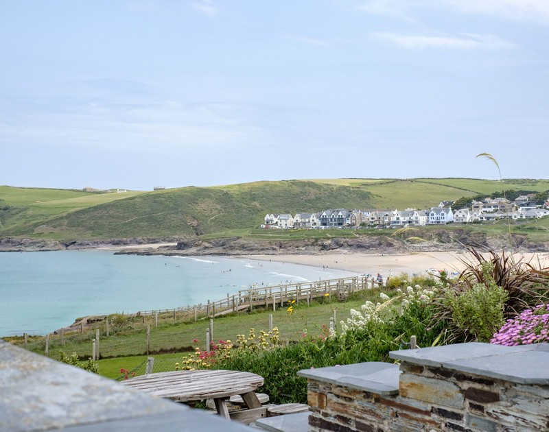 The sea views towards New Polzeath from the sunny terrace at Treleven Cottage in North Cornwall.