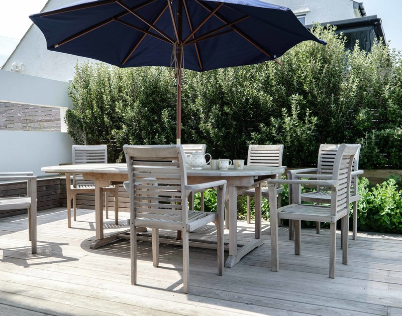 The sunny terrace with outside seating at Treleven Cottage self catering holiday home in Polzeath, North Cornwall.