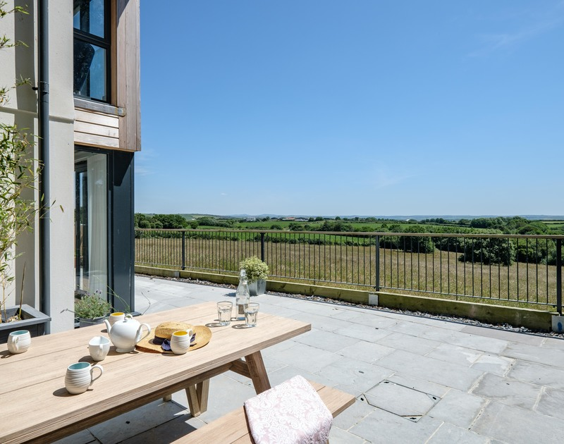 The beautiful countryside views from the terrace at Tor View self catering holiday home St Minver, Rock.