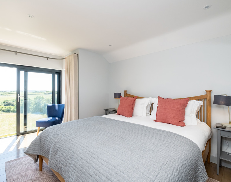 The double bedroom with ensuite and Juliet balcony at Tor View self catering holiday home in St Minver, North Cornwall.