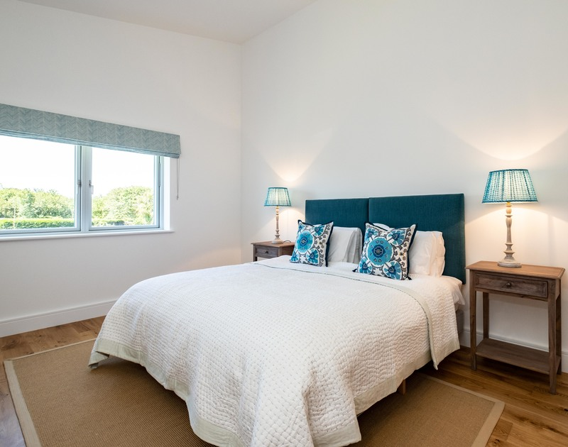 The master bedroom with an ensuite bathroom at Artemis self catering holiday home in Rock, North Cornwall.