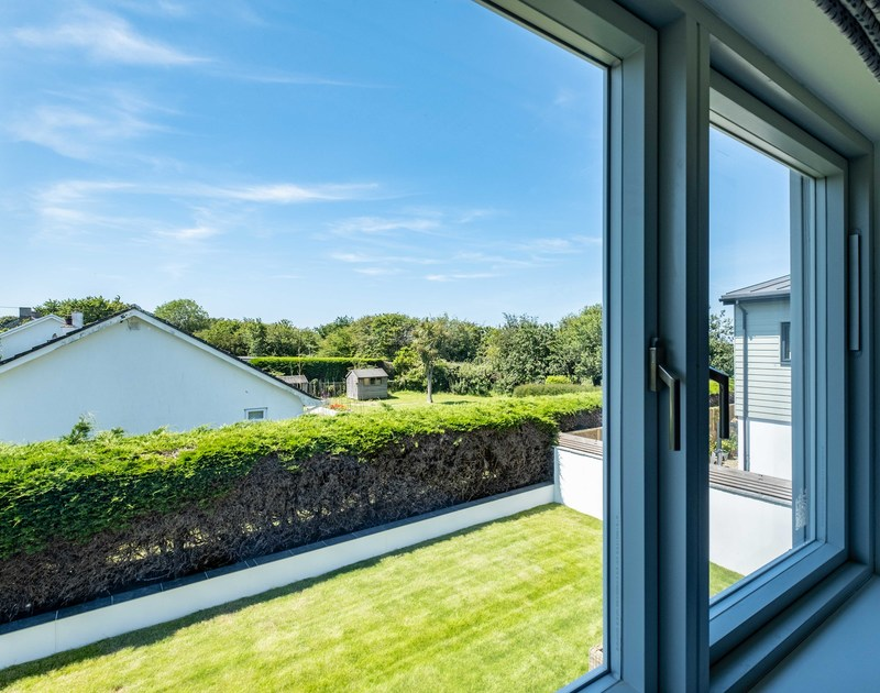 The view from the twin bedroom over the garden at Artemis self catering holiday home in Rock, North Cornwall.
