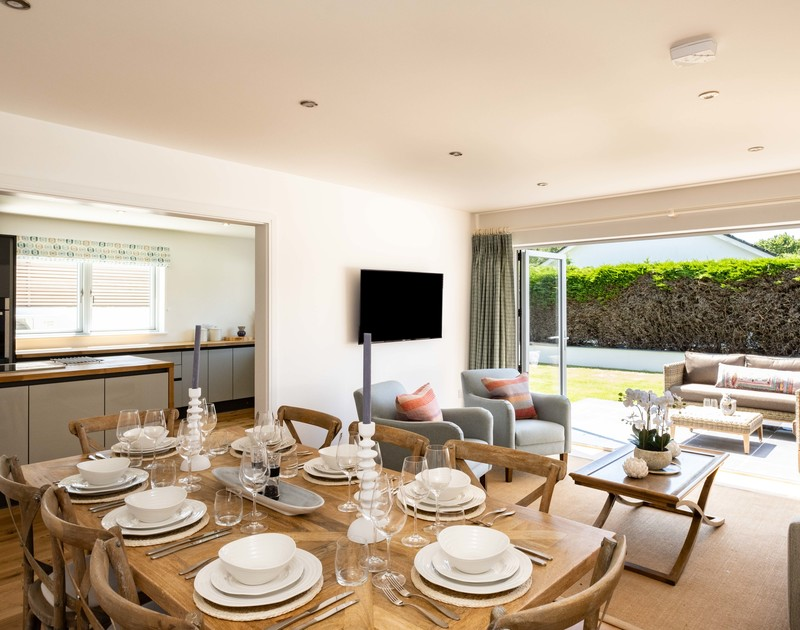 The open plan dining / lounge area at Artemis self catering holiday home in Rock, North Cornwall.