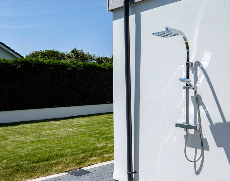 The outside shower in the garden at Artemis self catering holiday home in Rock, North Cornwall.