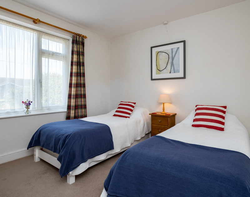 The twin bedroom with extra pullout beds at Lerryn self catering pet friendly holiday home in Rock, North Cornwall.