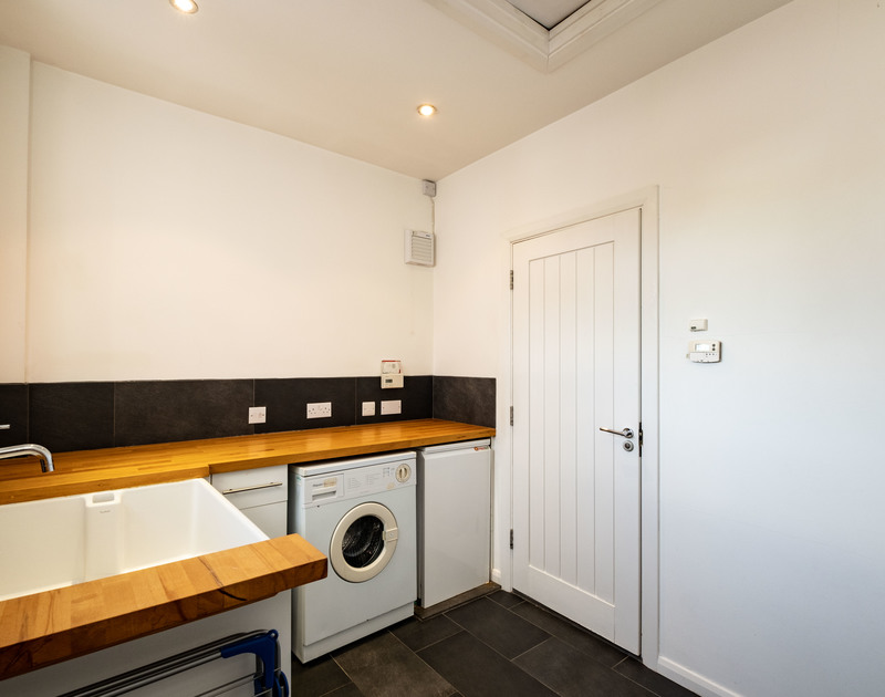 The well equipped utility room at Lerryn self catering holiday home in Rock, North Cornwall.