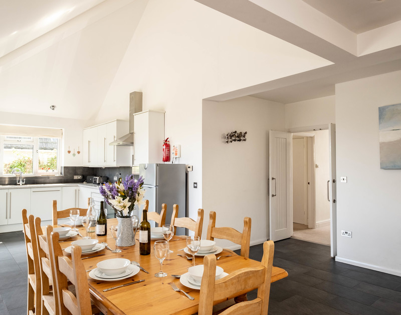 The light and airy dining area at Lerryn self catering holiday home in Rock North Cornwall.