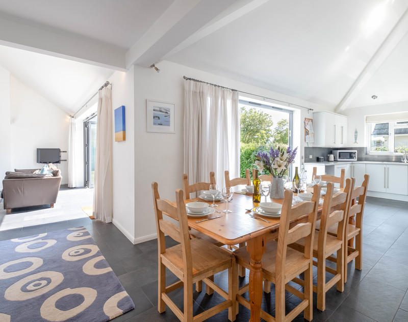 The spacious open plan kitchen, dining and lounge area in Lerryn, a self catering holiday house in Rock in North Cornwall.