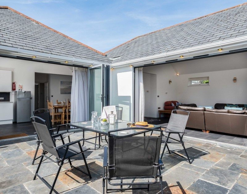 The large patio at Lerryn self catering holiday home in Rock, North Cornwall.