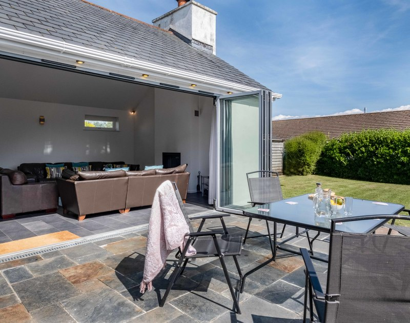 The sunny patio and garden at Lerryn self catering holiday home in Rock, North Cornwall.